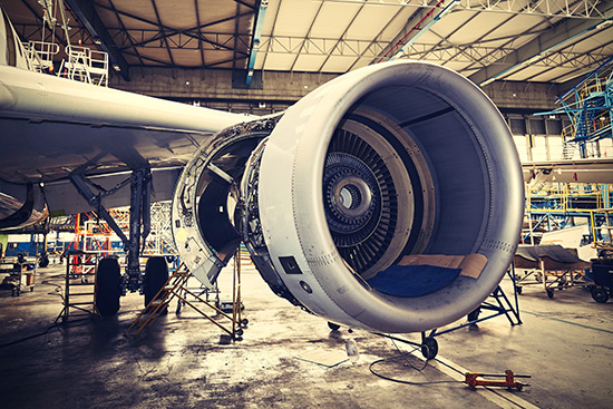 a plane jet engine open for inspection and servicing