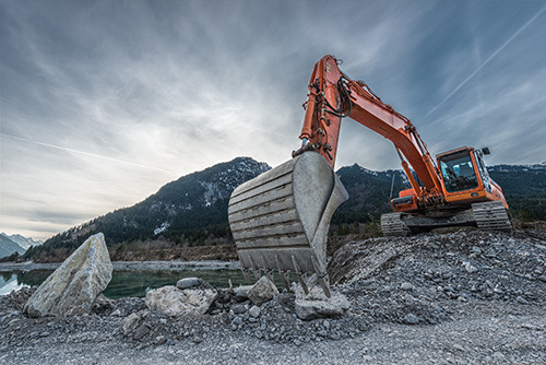 excavator being used on a rocky terrain